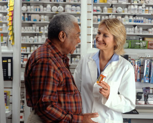 man_consults_with_pharmacist_3-300x240